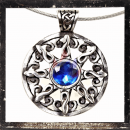 Celtic, round pendant with ornaments & 1 *BLUE* cut glass stone